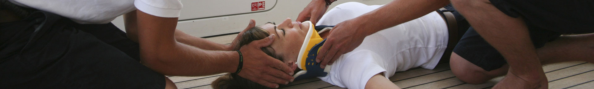 A casualty in a neck brace receiving medical attention