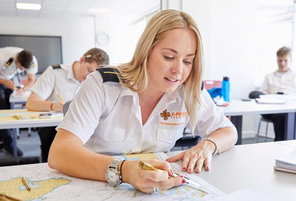 female cadet studying a map at the St Mary's campus