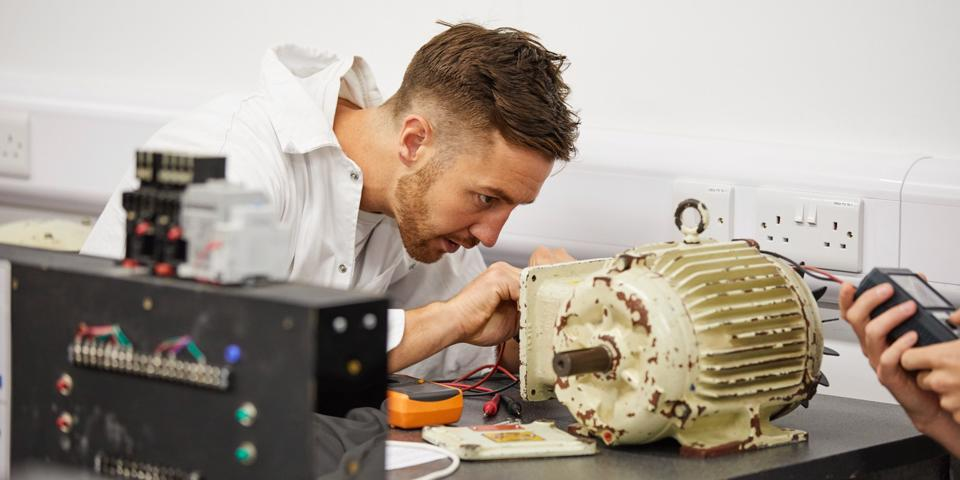 Engineer fixing a motor