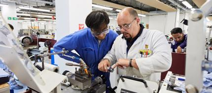 Eningeering cadet and lecturer in the Marine Engineering Workshop