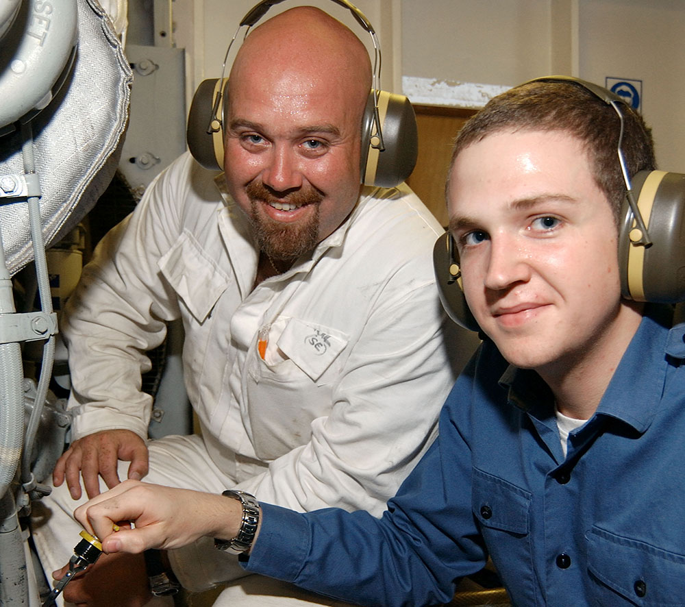 A junior RFA engineer with a senior engineer officer in the engine room