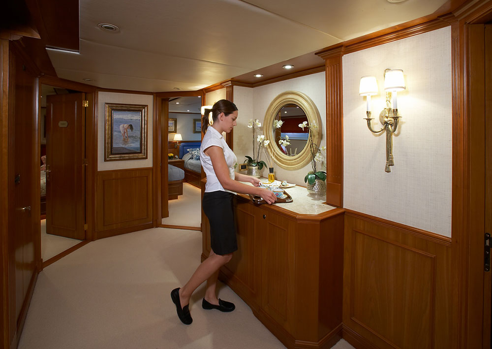A stewardess carrying a tray on board a superyacht
